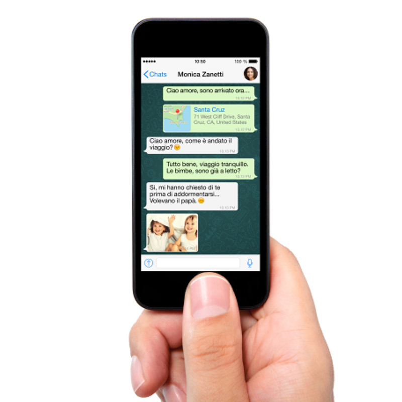 isolated man hand holding the phone with sms chat on a screen