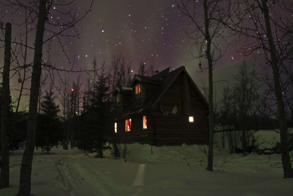 Aurora_and_house,_Wiseman_,_Alaska_,_USA